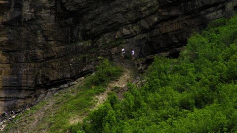 People walking at the base of Bridal Veil Falls in Provo, Utah Footage