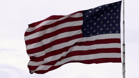 United States flag waving in the breeze ビデオ