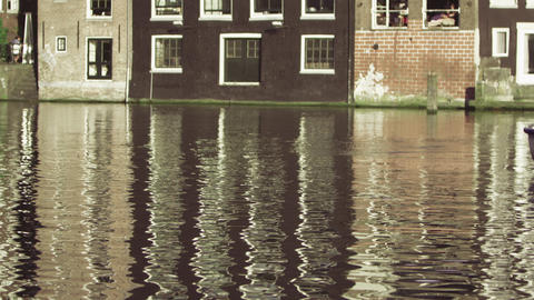 Static shot of buildings and the river canal in Amsterdam, Netherlands Footage