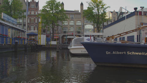 AMSTERDAM, NETHERLANDS - CIRCA 2013: Tracking shot of Amsterdam from a boat on 2 Footage