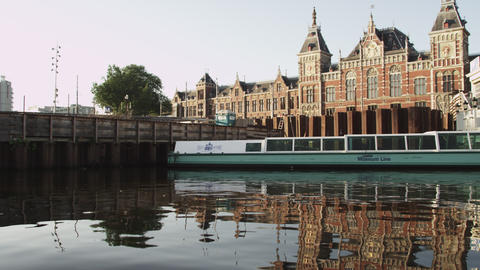 AMSTERDAM, NETHERLANDS - CIRCA 2013: Tracking shot of buildings at the waterfron Footage