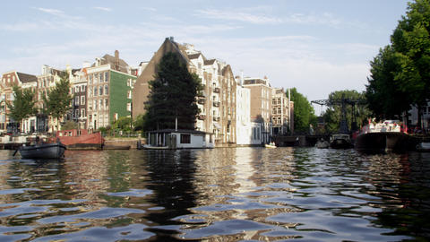 Tracking shot of buildings along the Amsterdam canal Footage