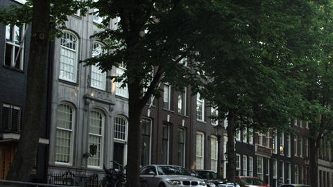 AMSTERDAM, NETHERLANDS - CIRCA 2013: Tilting tracking shot of buildings and a st Footage