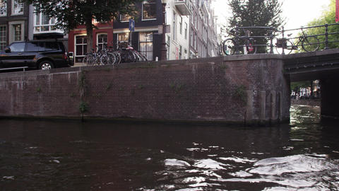 Going under a bridge in the canal in Amsterdam, Netherlands Footage