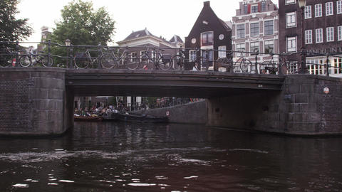 AMSTERDAM, NETHERLANDS - CIRCA 2013: Tracking shot of people and a bridge near E Footage