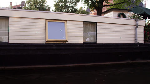 Tracking shot of beautiful houseboats on the canal in Amsterdam, Netherlands Footage