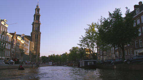 AMSTERDAM, NETHERLANDS - CIRCA 2013: Panning shot of Clock Tower and other build Footage
