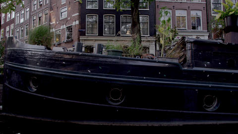 Tracking shot of houseboat community on the canal in Amsterdam, Netherlands Footage