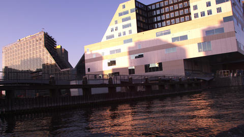 Tracking shot of modern buildings near the Centraal Station in Amsterdam, Nether Footage