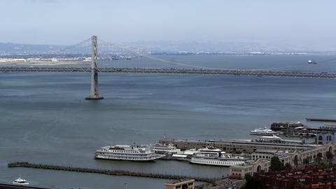 Pan of San Francisco Bay Bridge and buildings Footage