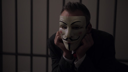 View of Anonymous hacker man in prison Footage