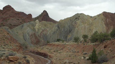 Panning shot of rock and brush layers with small creek Live Action