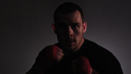 Close-up shot of a fighter shadow boxing towards the camera Footage