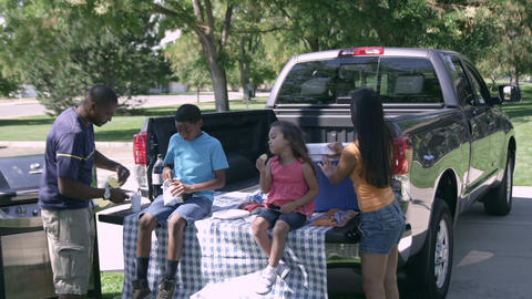 View of family having tailgate picnic Footage