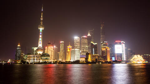 Time lapse of boats floating by with towers in the back in Shanghai China, at ni Footage