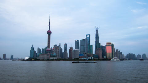 Time lapse of boats floating by with towers in the back in Shanghai China, at su Footage