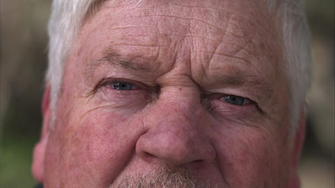 Up close view of older mans eyes while smiling Footage