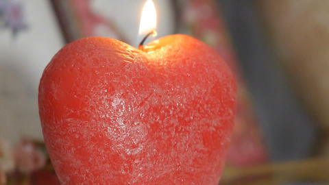 The decor. Panorama of a burning candle in the form of an apple Footage