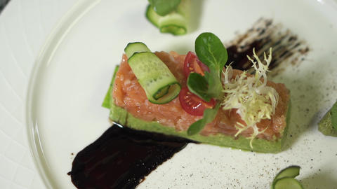 Delicious appetizing dish on a white plate in an expensive restaurant Live Action