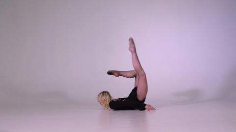 Young woman doing gymnastics backbend pose in slow motion GIF