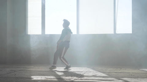 Young rapper dancing in an abandoned building. Hip hop culture. Rehearsal Live Action