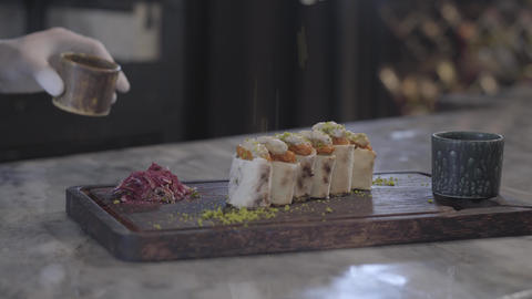 Chef cooking tasty dish in modern restaurant close up. Man sprinkling lula kebab Footage