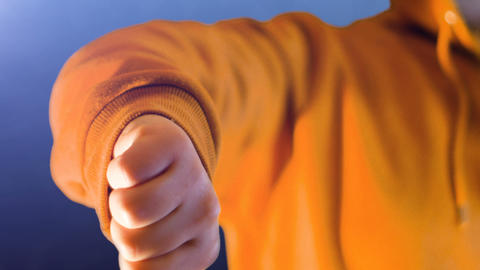 teenage girl with orange sweatshirt, she makes like and do not like with her Live Action