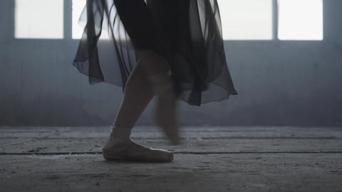 Ballet practice. Beautiful foot of young ballerina in pointe shoes. Beautiful Footage