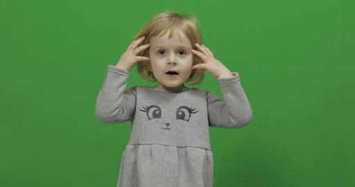 Kid girl on a Green Screen, Chroma Key. Happy three years old girl Footage