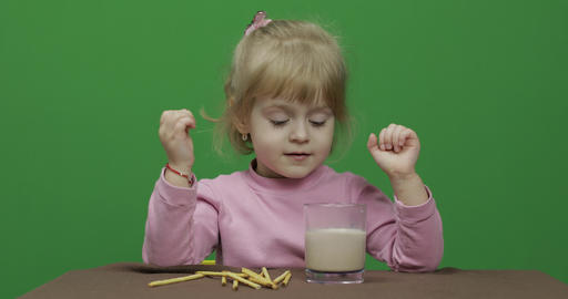 The child eats cookies. A little girl is eating cookies… Stock Video Footage