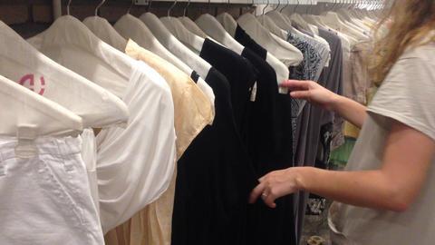 women pick choose cloth dress shopping check Stock Video Footage