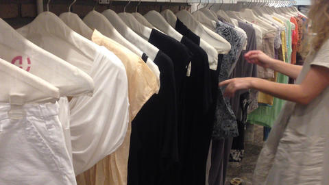 women pick choose cloth dress shopping check Footage