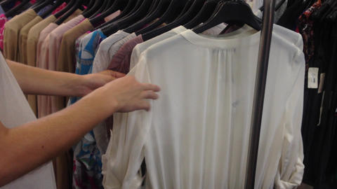 women pick choose cloth dress shopping check Stock Video Footage