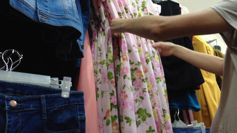 women pick choose cloth dress shopping Footage