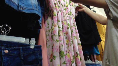 women pick choose cloth dress shopping Stock Video Footage