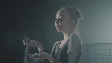 Portrait of professional female dancer in black dress in the studio on black Footage