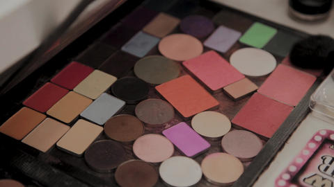 A palette with eye shadows and a makeup brush: women's cosmetics. Morning make Footage