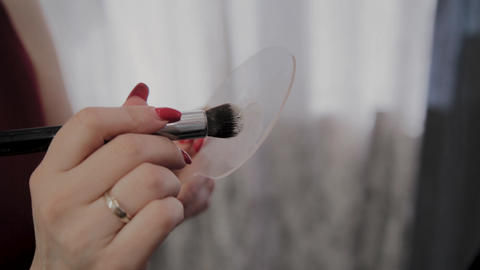 Professional makeup artist holds tool for visage in hands Footage