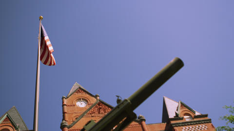 Upward view of flag waving at Cass County Courthouse Live Action
