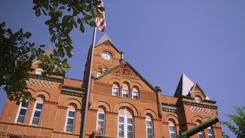 Dolly upward view of the Cass County Courthouse Live Action