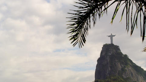 Pan of cloudy Rio sky and Christ statue Footage