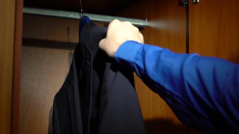 Placing a jacket into a wardrobe Footage