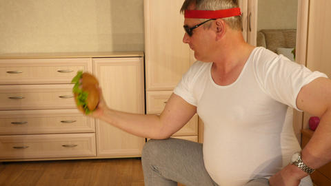 Fat man doing fitness with a huge sandwich Live Action