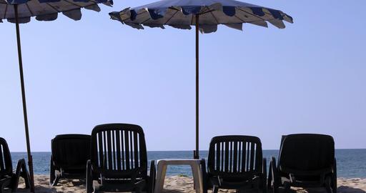 Sun beds background calm sea Live Action