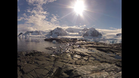 Mountain view from ship at sunset in Antarctica Live Action