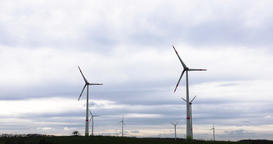Wind Turbines Propellers Rotating and Cloudscape in Time Lapse Live Action