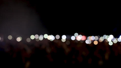 People at a rock concert with their flashlights on and hands up in the air Footage