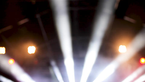 Blured strobe lights iluminating the ceiling of a concert hall Footage