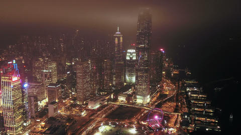 Aerial view of Hong Kong Downtown and Victoria Harbour with rain storm and fog. Financial district, Live Action