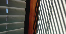 Sunlight Through Window Blinds and Shadows in Time Lapse Footage